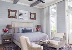 In this Florida bedroom, two sets of French doors swing open to a porch overlooking the pool terrace. - Photo: Jean Allsopp / Design: Georgia Carlee