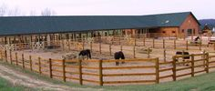 Log homes and horses seem to go together. This custom horse stable & riding area was designed by the Golden Eagle Log Homes design staff. In the background, on the far right side of the photo, you'll notice a modified version of our Country's Best floor plan.