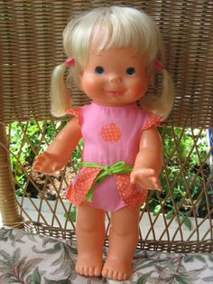 Whoopsie Doll-squeeze her tummy & her pig tails would flap up & down!