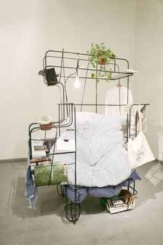 Idol (Michael Tomalik, 2014): an iron-wire chair that leaves room for the entire symphony of things you might want to have on hand while lazing away an entire afternoon in one.