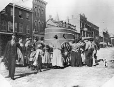 In the summer of 1893, it was hot and it was dry. There was a drought, and that September the City's water intake pipe broke. This meant that water had to be brought in by wagon—people would go out into the street to meet the wagon and fill their buckets, cans and other containers. This picture was taken on York Street, looking north from Adelaide Street West.