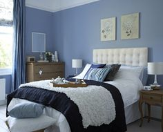 Brown, white and blue bedroom.      Source Missouri Home Inspection