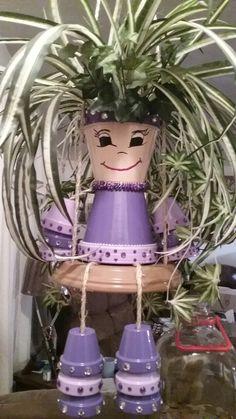 Clay pot doll