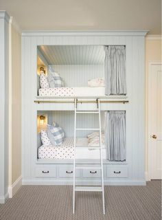Isn't this the cutest bunk room? It's feminine, but not overly girly. Love the mix of polka dots, buffalo check, gingham and floral. So, so cute! The mix of metals, the indoor/outdoor caged light, the rolling ladder. Especially love that you know this is a girls bunk, but they painted it that beautiful soft blue and just added the hint of pink in the bedding.