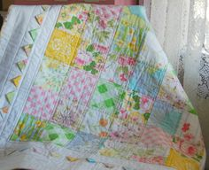 Love everything about this sweet quilt, the fabric choices, the layout, the white border with prairie points, the simple quilting, so cute!  happy little cottage: Ana's Quilt