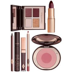 Charlotte Tilbury The Vintage Vamp ($230) ❤ liked on Polyvore featuring beauty products, gift sets & kits, beauty, makeup, travel bag, cosmetic purse, makeup purse, cosmetic bag and vintage travel bag