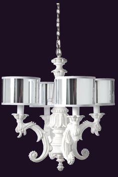 White Chandelier perfect for powder room complemented by dramatic wall covering.