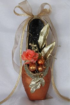This intricately decorated ballet shoe makes the perfect gift for that special memory on stage. Made from a NEW shoe that has been carefully embellished, it evokes the spirit of the dance. ☆ It measures approximately 10x3. There is a small loop on the back of shoe for hanging. ☆ I can