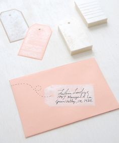 Pink envelopes and pretty handwriting.