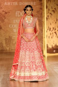 How pretty is this pink red bridal lehenga by Anita Dongre #Frugal2Fab