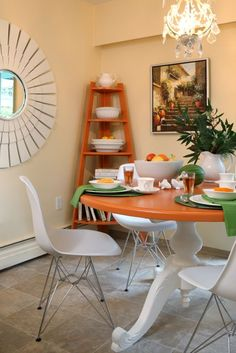 Kitchen Dining Area -- paint a traditional table a funky color on top. Do this for the kitchen!