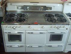 Late 1940s Roper  8 burners, griddle, 2 ovens, center large broiler, 2 broilers under ovens, center storage drawer.  *Wow!*