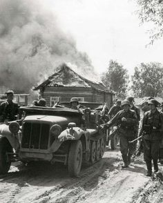 An advance party from the Das Reich motorized anti-tank company pass through a Soviet village which retreating Red Army set on fire. The vehicle with the Wolfsangel symbol and tactical sign on the front left is a Sd.Kfz.10 towing a 3.7 cm Pak 36 anti-tank gun