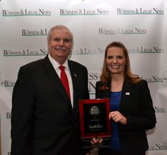 Rogers State University Innovation Center director, Jeri Koehler, accepting her Top 40 Under 40 award from Tulsa Business & Legal News publisher, Chuck Branch.