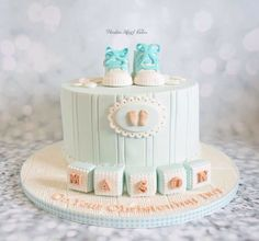 Boys christening cake with sugarpaste baby converse and blocks