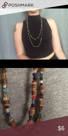 Necklace Very long beaded necklace, can be worn long or doubled over. Beads are wooden and plastic. Jewelry Necklaces