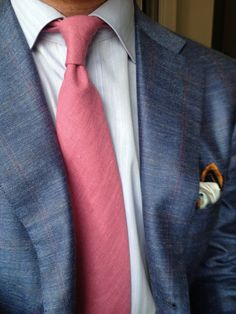 If you are going to have a suit with a pink stripe, you might as well have a pink tie. Textures line up nicely.