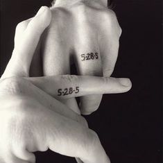Adding your wedding date to your finger is a creative wedding band tattoo idea.