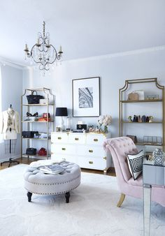 This chic office is inspired by Paris with its white and blush pink tones, statement crystal chandelier and gold accents, but is also brushed with indisputable evidence of Old Hollywood glamour.