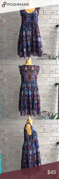Anthropologie Lili's Closet Sibylline Ikat Dress Love the vintage vibe of this ruffled mini dress for Anthropologie by Lili's Closet. Size small. No damages to note. Lovely Ikat print goes with EVERYTHING! I have another version of this Sibylline dress, and adore wearing mine over a rad pair of flare jeans and platforms! So cute!!! Please let me know if you have any questions. Thank you for looking! Anthropologie Dresses Mini