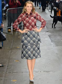 Blake Lively in a crimson and gray gingham jacket layered under a matching dress.