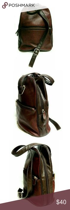 """AURIELLE GENUINE LEATHER CARRYALL/BACKPACK BAG AURIELLE GENUINE LEATHER CARRYALL/BACKPACK BAG Pre-Loved/EUC Front & Back Zip Pockets Adjustable Strap Zipper Pocket & Spacious Interior  Approx Meas;    H   12""""  L  9""""  W   5""""  Colors May Not be Exact Due to Lighting or Ur Screen Measurements. Are Approx & Can be Interpreted Differently on How U Measure it Aurielle Bags Backpacks"""