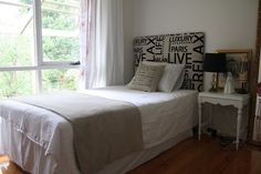 small bedroom. upholstered bed head , French style fabric