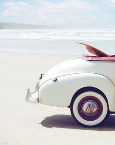 White car on white beach