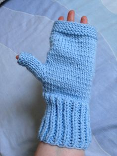 These beautiful soft blue fingerless gloves are perfect for the chilly weather. The thumb and fingers are free and so you can easily type, text, or whatever else you need to do. They are made in a beautiful shade of light blue using aran yarn. The wrist and top of the gloves are ribbed whereas the main part of the glove is in plain purl stitch. They measure approximately 22cm/9in in length and 20cm/8in in circumference. The little thumb section is 6cm/2.5in in length and 6cm/2.5in in…