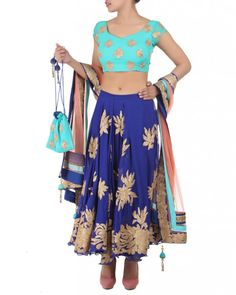 A multi-coloured lehenga featuring a Royal Blue Georgette skirt, a Ceramic Georgette Blouse with a Coral Net Dupatta. The three colours provide a playful palette for the Gold Gota Patti work that has been carefully interspersed all over the skirt, the blouse and the border of the Dupatta. The Dupatta features a combination of all three colours along the border and is finished with beautiful latkans. #Ootd #Potd #Qotd #Fashion #Shopping #WomenWear #IndianWear #Style