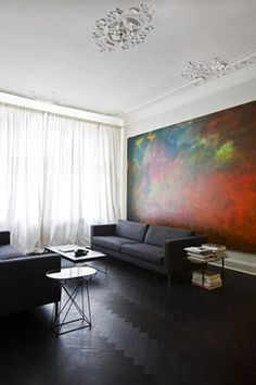 Love all the color from the massive painting!  And the black stained floor isn't bad either!