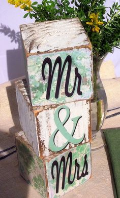 "DIY wedding decor: Mr and Mrs blocks. Would be a cute gift idea for newlyweds. Or use pictures instead of ""Mr"" or ""Mrs""."