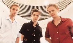 Chris Wolstenholme, Matt Bellamy and Dominic Howard of Muse