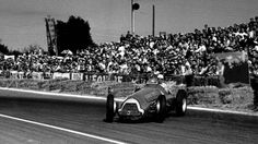 Having given up his car to Juan Manuel Fangio in the 1951 French Grand Prix, Luigi Fagioli has a lurid moment in the Argentinian's Alfa. Fagioli went on to finish 11th in Fangio's car - but shared victory too. © LAT Photographic