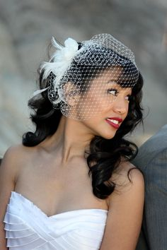 birdcage veil with hair down | Birdcage veil with feather hairpiece