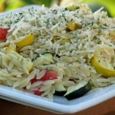 Wonderful summer vegetables - zucchini, summer squash, asparagus, and mushrooms - are roasted and mixed with warm orzo and Parmesan cheese.