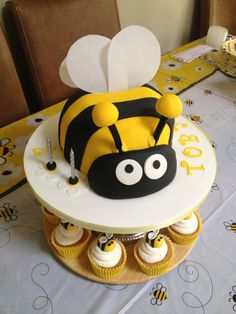 Bumble bee cake with cupcake hives and bees