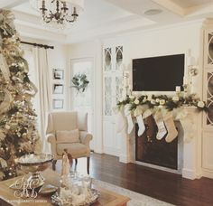 Elegant Christmas family room with flocked Christmas tree by Randi Garrett Designs white christmas Flocked Christmas Trees, Christmas Mantels, Merry Little Christmas, Family Christmas, Christmas Tree Decorations, Christmas Florida, White Christmas Stockings, Christmas Diy, Christmas Inspiration