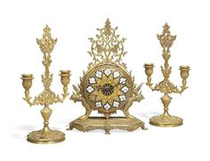 A NAPOLEON III ORMOLU AND YELLOW ENAMEL THREE-PIECE CLOCK GA