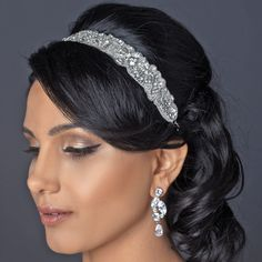 """This beautiful rhinestone and beaded floral swirl bridal elastic headband will add that extra special touch to any brides attire. Available in a silver or gold tone. Design - 13 1/2"""" x 1"""" Elastic - 7"""""""