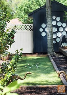 Play (bocce) ball --or horseshoes or corn hole. Blogger Kristin Jackson made room for fun outdoor games. Her backyard makeover uses faux grass and fab flamingos painted gold. Get her design tips here.