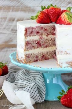 This fresh homemade Strawberry Cake is covered with a lemon Swiss Meringue Buttercream. The cake is incredibly moist and bursting with fresh strawberry flavor. Homemade Strawberry Cake, Fresh Strawberry Cake, Strawberry Desserts, Swiss Meringue Buttercream, Buttercream Recipe, Cake Recipes, Dessert Recipes, Dessert Ideas, Cakes Plus