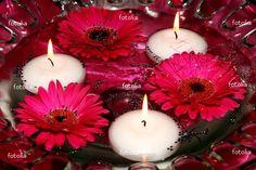 floating gerbera daisies and tealights