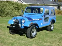 1976 Jeep CJ-7 Renegade in Brilliant Blue with Levis interior, Blue BestTop Soft Top, factory V8 engine and Warn special edition 8274 winch.
