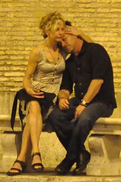 Meg Ryan and John Mellencamp get handsy in Rome
