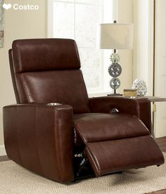 The Graham Top Grain Leather Media Recliner by Abbyson Living is a must have for your entertainment area or a casual living room, with its easy power operation and luxurious seating. Graham provides 2 armrests, each with stainless steel cup-holders, as well as seating which features an electrically powered recliner that offers an infinite selection of positions.