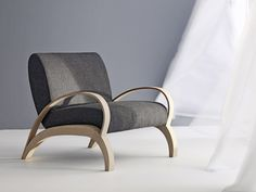 Upholstered relaxing armchair with armrests SPRING by Passoni Nature | design Arturo Montanelli, Ezio Riva