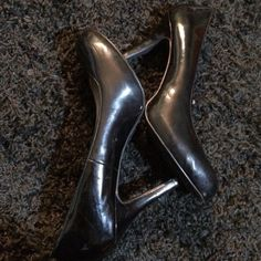 Black Heels Shiny, black, faux leather black heels from Fioni. Hardly ever worn, in good condition. There are some scuff marks and scratches and minimal wear and tear, but they've still got plenty of life in them. They look great with the white formal dress in my closet 😉 Size 8, but my narrow ankles and feet do not fit quite right in them. Make me an offer! FIONI Clothing Shoes Heels