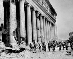 Post Office bombed-soldiers in front