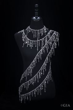 This stunning 18K white gold diamond sautoir (a very long necklace) by Diarough has 404 rough diamond crystals weighing a total of 813 carats. It also has 7,241 polished diamonds weighing a total of 584 carats. Nicole Kidman wore it to the 2008 Academy Awards.